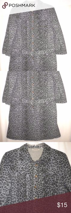Jeanology Collection Women Size 10 Tunic Dress Barely Worn. Jeanology Collection Women Size 10 Tunic/Dress. 3/4 tab sleeves.  Metal button front.  Belt loops. Black and charcoal leopard print. Denim/Jean. Made of 100% Cotton. Chest approximately 38 inches and length approximately 35 inches.  Back top of shoulder seam to seam lying flat approximately 16 inches, top of shoulder seam to end of cuff approximately 18 inches, lying flat along the bottom approximately 23 inches for a total of…