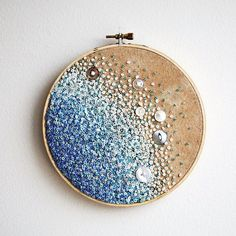 Calm Blue Sea -  Gradient Embroidery Hoop Art - French Knots, Beads, and Vintage Buttons. $70,00, via Etsy.