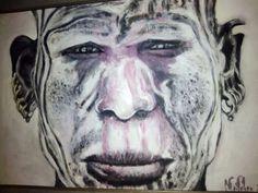 Africano con el rostro  pintado acrilico