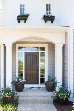 Summer Home Tour – The Lilypad Cottage – farmhouse front door with screen Front Door With Screen, Brown Front Doors, House Front Door, Front Door Decor, House Entrance, Traditional Front Doors, Single Story Homes, Farmhouse Front, Street House