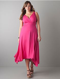 The favorite trends of the season come together in this twist strap maxi  dress with an asymmetric shark bite hem.  Curve-flattering dress shows  off your figure with a sexy surplice neckline, elastic waist for a  defined hourglass shape and A-line silhouette. This versatile basic is  great for casual or dressy occasions. lanebryant.com