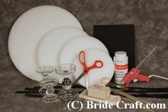 Homemade Graduation Centerpieces Craft | Cons: Easy to not use enough glue and to not center the disks ...