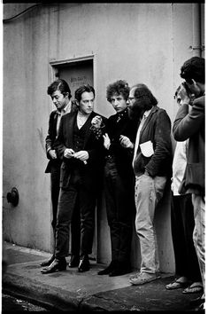 """The poets"" outside City Lights Bookstore, San Francisco, 1965. Lawrence Ferlinghetti, Michael McClure, Bob Dylan and Allen Ginsburg."
