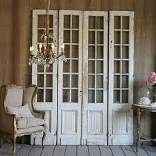 Decorative Home Idea: find white old doors at an antique store, leave them their natural look, and set up against a wall. For extra accents add other antique decorations: Chairs, ables, flowers, or even a pretty chandelier.