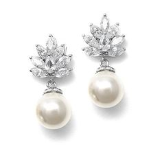 Classic pearl bridal earrings feature a cluster of CZ's with an elegant cream colored pearl drop accented in silver.