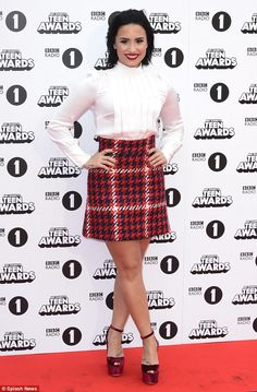 Confident: Demi Lovato, 23, absolutely stunned on the red carpet for the BBC Radio 1 Teen Awards at London's Wembley Arena on Sunday