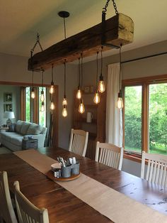 "Add a rustic, industrial feel to your home, restaurant, bar or wherever with a reclaimed barn beam light fixture. Beams are reclaimed from 100+ year old barns from the Midwest. Height and width of most beams are between 7-9"". Not all beams are the same. Some may contain more or less"