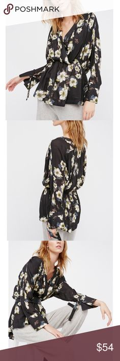 NWT Free People floral wrap top New with tag. Free people floral printing top. Wrapped design with elastic at the waist. Flares sleeve cuffs with tie accent. They run big!!❤FREE free people reusable fabric bag❤ Free People Tops Tunics
