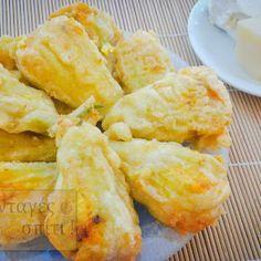 Κολοκυθοανθοί γεμιστοί με φέτα, γραβιέρα και σταφίδες τηγανι... Snack Recipes, Snacks, Feta, Shrimp, Pineapple, Chips, Fruit, Desserts, Image