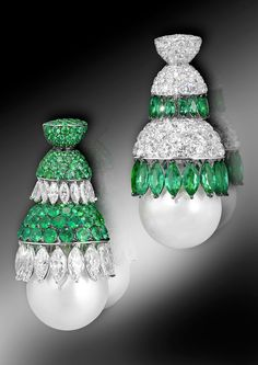 de GRISOGONO's white gold earrings feature two South Sea pearls, 31 marquise-cut white diamonds, 31 fancy shape-cut emeralds, 169 white diamonds and 169 emeralds.