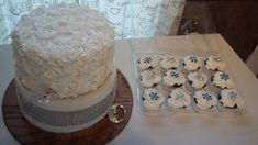 small wedding cake with matching cupcakes