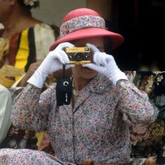 The Queen often gets behind the lens herself to take photos of the Duke of Edinburgh carriage driving and while on tour. Here she is taking photographs with her gold Rollei camera during her visit to the South Sea Islands of Tuvalu.