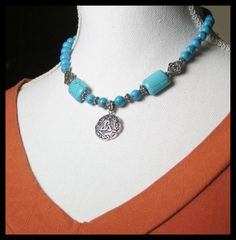 http://www.sellergroup.com/shop/TelumaDesigns  925 Sterling Silver Celtic Pendant on a necklace of Turquoise, Blue Howlite and Sterling Silver. Blue Gemstones and decorative Sterling Silver beads. Hand made, One of a Kind Jewelry. (Code 346N)