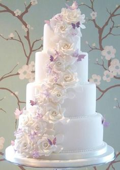 Wedding Cake Ideas Start your own Wedding Cake Business! White roses and lilac butterflies WeddingCakeSource From White roses and lilac butterflies WeddingCake. Elegant Wedding Cakes, Beautiful Wedding Cakes, Gorgeous Cakes, Wedding Cake Designs, Pretty Cakes, Cake Wedding, Trendy Wedding, Amazing Cakes, Purple Wedding Cakes
