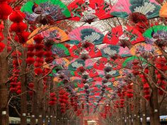 Paper Fans Lucky Red Lanterns Chinese New Year Decorations Ditan Park Beijing China. During Lunar New Year, many parks and temples in China have large outdoor fairs, festivals. Chinese characters on lanterns say lucky and long life.