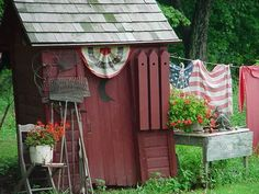 Is this a potting shed, pump house, or outhouse?  It really does not matter.  It speaks to my heart.  I do not like corny, but this is a theme designed vignette that is not corny.  This makes me want to stand at attention and salute Old Glory.  I pray it becomes fashionable to be patriotic again.  When a vacuum is left because we no longer stand for the good, it will be filled by tyranny.  God bless the U.S.A.