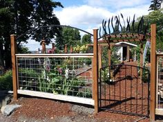 Another deer fencing idea.  Love the metal arch on top.