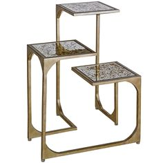Startling in its dramatic presence and ingenious contour, this table is ideal for open spaces. Three layered surfaces, each finished in attractive Antique Gold Leaf Mirror, provide the centerpiece for