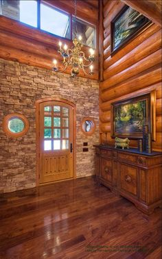 Foyer of a log home in designed several years ago in the Catskills. #loghomes #loghomedesign #postandbeam #handcraftedlog For more photos of this or more of my designs, please check out my website, www.designma.com, my Design Page, www.facebook.com/loghomedesign — in Shandaken, New York.