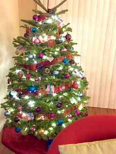 """The Grand Budapest Hotel:  """"The Grand Budapest Hotel"""" themed Christmas tree.  #decor #DIY, #Wes Anderson Themed, #Christmas tree ideas, Decorations, #pink, Robbins egg blue, red, purple, gold, brown"""