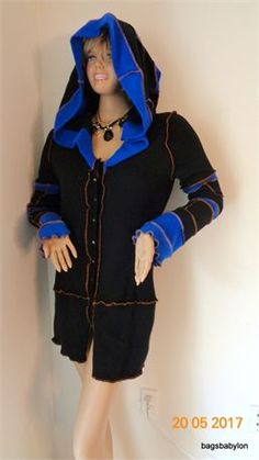 100% cashmere cardigan in an eye appealing colors : classic black and striking, Royal blue.The cardigan style hoodie jacket has button up closure with lovely small buttons. The extra long hood gives even more interest to the totally unique look of this garment.  Let me tell you few words about the process of creation.... All cashmere sweaters went a long journey before become my creative material: carefully hand picked , hot water laundered in the best wool detergent and dried on the hot…