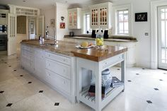 The cream kitchen units were built by Tierney Kitchens. The counter tops are French marble