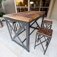 X Brace style reclaimed wood / steel outdoor patio table with matching bar stools. #porterbarnwood #porterironworks #patiotable #reclaimed #barnwood #outdoorfurniture #interiordesign #modern #rustic #industrial