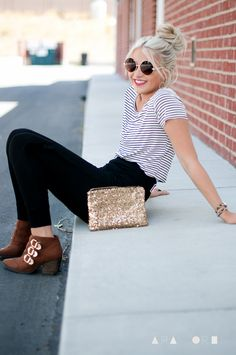 Striped shirt, high waisted pants & ankle boots.