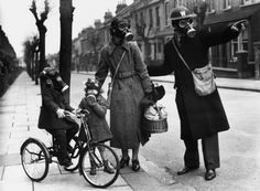 A warden gives directions to a mother and her two children during a World War II gas drill in Southend on Marcy 29, 1941. via reddit [[MORE]] Source