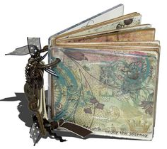 Altered Book - use an old board book, add scrapbooking paper and embellishments, punch holes and add rings.