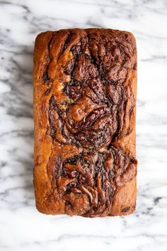 The softest banana bread you've ever had swirled with thick ribbons of Nutella. And with only 6 tablespoons of butter in the entire loaf it's practically low-fat!