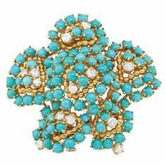 Gold, Turquoise and Diamond Clip-Brooch, Tiffany & Co.  ~  18 kt., the pierced flower embellished by round cabochon turquoises, accented by 13 round diamonds approximately 1.25 cts., the center and petals outlined by polished gold balls