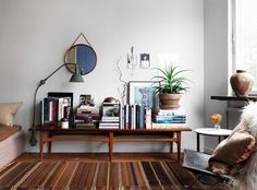 Mid Century Modern coffee tables don't have to be in front of a couch. ~ Mary Wald's Place -A Tiny Stockholm Studio with Tons of Style