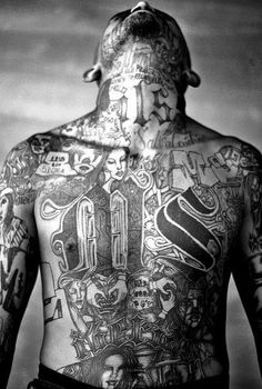 Chelatenango, El Salvador. May 2007. A members of the Mara Salvatrucha gang displays his tattoos inside the Chelatenango prison in El Salvador. Moises Saman Panos Pictures