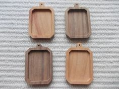 4pc unfinished rectangle shaped pendant base with round hook and slightly cut corner,rectangle blank pendant setting/base bezel cup  4 pieces dark walnut/cherry wooden rectangle shaped pendant/brooch base for jewel making. In the centre of the pendant there is a rectangle-shaped cabochon frame/hole, which gives a more attractive look to the pendant.  https://www.etsy.com/listing/191196530/4pc-unfinished-rectangle-shaped-pendant?ref=related-1