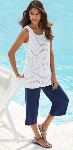 Picture yourself poolside in our white cutwork cotton top. Soma | Getaway
