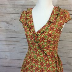 """""""Cheerio"""" serendipity Matilda Jane dress This a cute green and orange wrap dress perfect for this spring !!! This dress is 34"""" long this dress is in perfect condition. Matilda jane  Dresses Midi"""