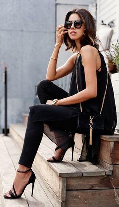 Shop this look on Lookastic:  https://lookastic.com/women/looks/tunic-leggings-heeled-sandals-crossbody-bag-sunglasses-bracelet-watch/12540  — Dark Brown Sunglasses  — Gold Bracelet  — Black Chiffon Tunic  — Gold Watch  — Black Suede Crossbody Bag  — Black Leggings  — Black Suede Heeled Sandals