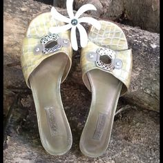 "BRIGHTON slip on sandals These Brighton Sandals are great for the upcoming summer months. In excellent condition. Creamy gold color with silver brighton bling. 1.5"" heel. Brighton Shoes Sandals"