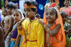 Indian children dressed as Hindu god Lord Krishna and his consort Radha pose at a fancy dress competition on the occasion of Janamashthami in Hyderabad on August 25, 2016.