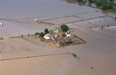 An aerial view of a farm house surrounded by flood waters along the South Platte River near Greeley, Colorado September 14, 2013. High number of loss... livestock and fields that were ready to be harvested. Feel for these farmers.  Loss of home and their livelihood.