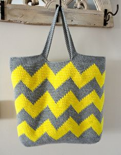 "Ravelry: kittinkilgore's Large Gray/Neon Yellow Chevron Crochet Tote ""Oblong oval bottom   Calculate number of zigzags in bottom to get even (approximately 9 sections of 16 stitches), place stitch marker every 16 stitches before starting chevron stripes starting at about round 10   Ch 60 for handles - 5 rows"""