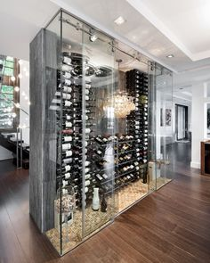 Contemporary Style - love the wine glass chandelier and over sized glass holding corks