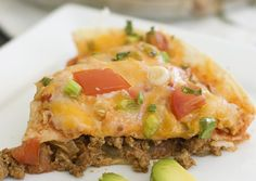 This Taco Bell Mexican Pizza recipe is made with fried tortillas, refried beans, seasoned ground beef, enchilada sauce, and melted cheese! Top Recipes, Copycat Recipes, Beef Recipes, Great Recipes, Dinner Recipes, Cooking Recipes, Favorite Recipes, Healthy Recipes, Dinner Ideas