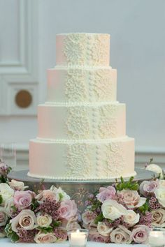 Lace detailing on the cake with a touch of pink... that is sooo pretty.