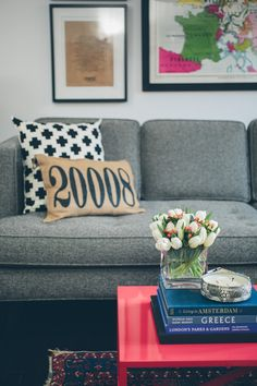 """My best friend (and business partner) Jessica gave the 20008 zip code pillow to us as a housewarming gift. Both pillows on the sofa are actually from Etsy – my favorite place to buy throw pillows."" - love the zip code pillow! My Living Room, Living Room Interior, Home And Living, Living Spaces, White Sofa Design, Black And White Sofa, Cute Pillows, Throw Pillows, Pink Table"