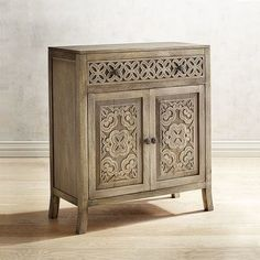 Handcrafted of mango and other hardwoods, the Tempe Chest is the perfect accent for your study, entryway or dining room. Intricately carved, it has a long top drawer and cabinet doors below, which conceal one stationary and one adjustable shelf. The modified saber legs are the finishing touch to this traditional treasure. By Dileep for Pier 1 Imports.