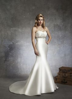 Justin Alexander wedding dresses style 8679 This mermaid silhouette is complemented by a sweetheart neckline pleated  in Regal Satin and accented with a beaded motif at the empire waist  line. Regal Satin and beaded buttons cover the back zipper and chapel  length train (Beaded belt is available as style A026).