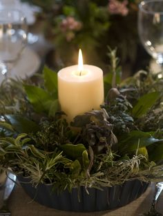 Herb Centerpiece -- Gather a selection of fresh, seasonal herbs such as rosemary, sage, thyme and bay leaves, and use them to create an alternative table centerpiece.