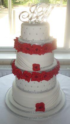 Red sugar roses and diamante wedding cake :)